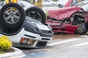 Rollover Vehicle Accident at Busy Intersection With Emergency Pe