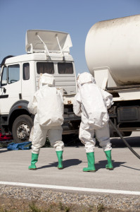 18-wheeler truck crash run over car chemical hazardous spill
